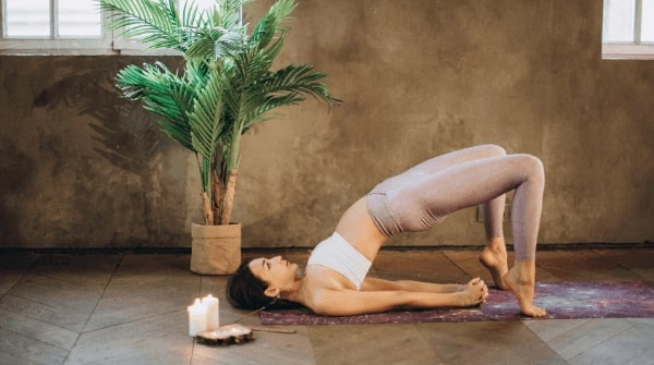 bridge pose also called as setu bandha sarvangasana yogic posture. Strengthens the back muscles, hamstrings, glutes. Also calms the nervous system