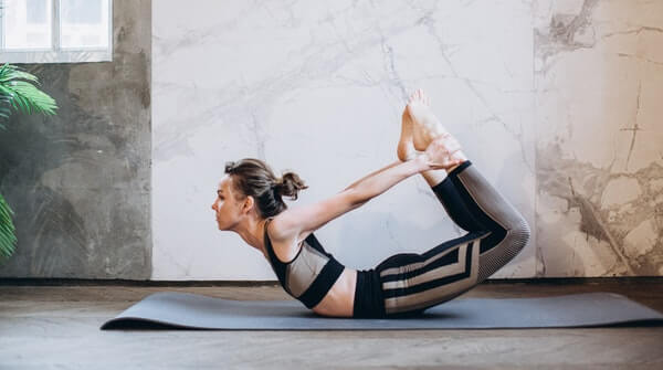 bow pose. Increases agility and flexibility