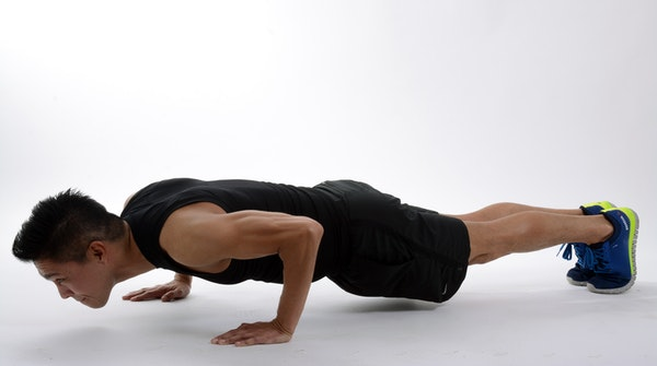 a man doing plank workout exercise at home. This one engages all the muscles in the body