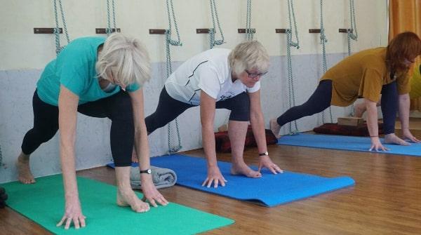 Yoga at home equestrian pose also called ashwa sanchalanasana. It tones muscles of kidney, liver.