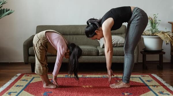Learn yoga at home-hastapadasana or hand to foot pose. It increases flexibility