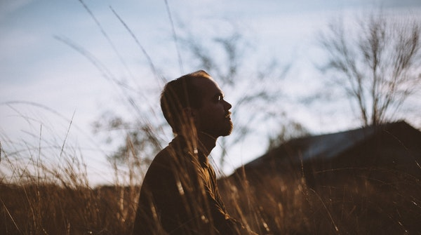 Techniques and Benefits of meditation-a man meditating outdoors