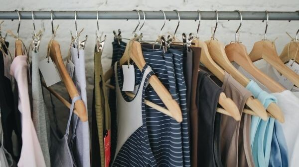 Rainy season clothes are hanging on hangers. Clothes made from lightweight materials.