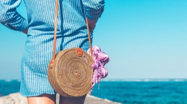 A woman with a beautiful jute bag. Bag looks perfect with a rainy season dress.