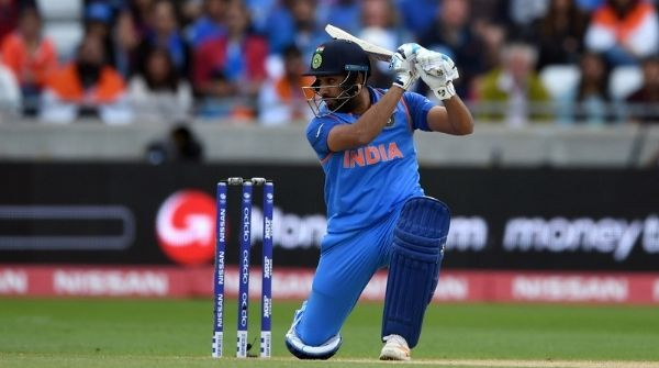 Rohit Sharma playing cricket on the field representing India