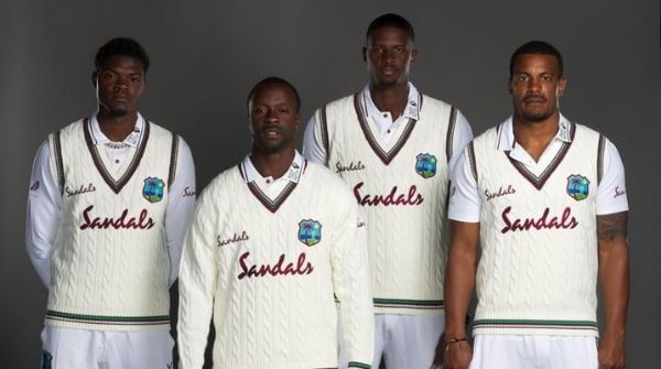 Windies cricket players in their Test jersey and trousers