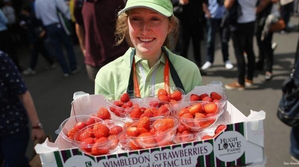 Traditional strawberries and cream consumed by the fans at the tennis tournament