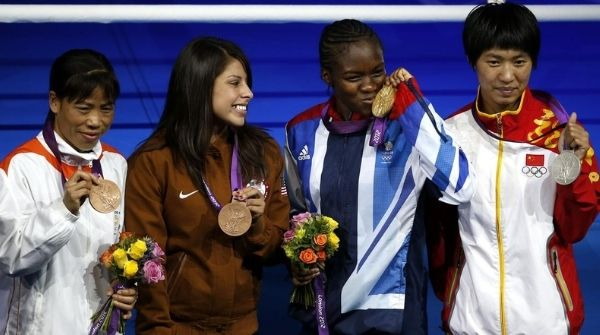 Mary Kom posing after winning the bronze medal at 2012 London Olympics