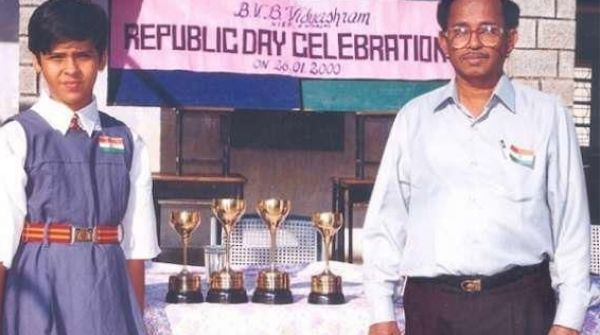 Nehwal standing with all her trophies from the school wins
