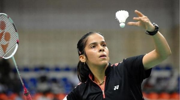 Shot of Nehwal going for her service in a Badminton match