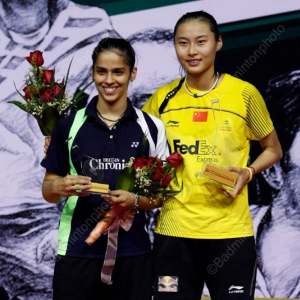 Two former World number 1 sharing a frame after Wang Yihan defeats the Indian Former World no 1
