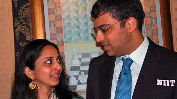 Anand with his wife on one of the days where he is seen endorsing NIIT Brand