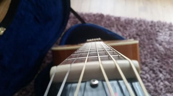 The neck of the guitar should be straight.