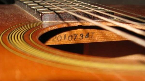 The guitar should have its serial number written on it.